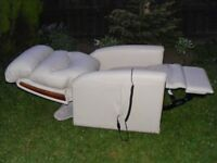 CAN DELIVER- DUAL MOTOR CREAM LEATHER RISE RECLINER CHAIR IN PERFECT CONDITION - ONLY 3 MONTHS OLD