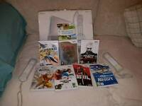 Nintendo Wii with 8 games and 2 controllers