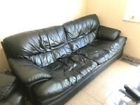 Black leather 3 seater sofa and black leather recliner chair. Collection only.