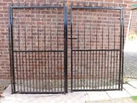 Never used pair of steel security gates measuring each 110cm wide and 180cm high.