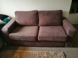 Two seater brown sofa