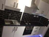 Black,cream and white gloss kitchen brand new and boxed.