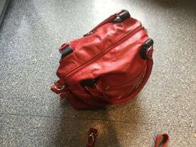 BRAND NEW blood red and black bag. 2 zip pockets outside & 2 larger zip pockets INSIDE.