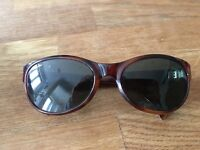 Ray ban sunglasses and case for sale. Good condition.