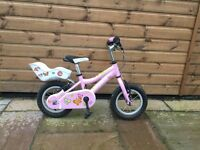 Girls bike with dolls seat excellent condition