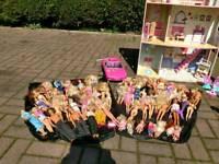Dolls house, Barbie dolls 55 total plus bits
