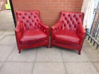 A Pair Of Oxblood Red Chesterfield Chairs
