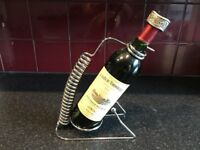 bottle of Chateau trimoulet grand cru st emilion and bottle stand
