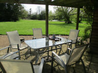 Elegant glass and aluminium garden table set ( 6 chairs)