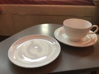 4 white teacups saucers and small cake plates