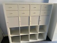 White shelving unit with storage