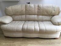 Cream 3 Seater sofa. Comfortable but slightly worn.
