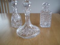 Three crystal decanters, Ship's, Port and Whiskey