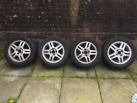 15 inch ford alloys 2excellent tyres 2 legal £75!!!!!