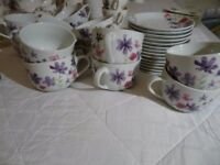 14 matching cups and saucers all only used once