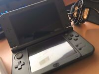 New Nintendo 3DS XL + Charger + 3 Games
