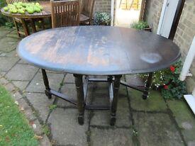 Vintage Solid Oak Oval Drop Leaf Table