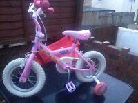 Peppa pig bike with helmet and stabilisers