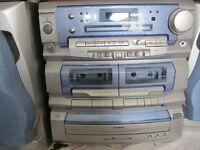 GOODMAN'S HiFi in perfect condition. Twin tape decks, 3 disc changer, record deck, radio, 2 speakers