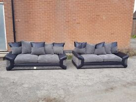 Comfy BRAND NEW sofa suite,pair of 3 seater black and grey cord sofas.brand new.can deliver