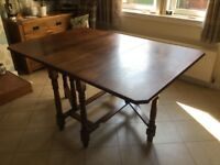 Dark oak dining table, double leaf, good condition
