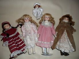 5 Vintage Collectable Dolls with ceramic face, full dress and stand