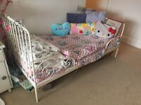 Extendable Childs Bed, white ornate metal frame and mattress.