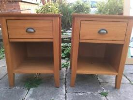Twin golden wooden bedside tables with metal handles