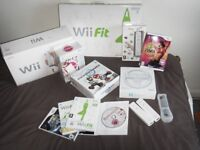 Nintendo Wii Bundle incl 1 white Console, 1 Wii Fit Board, 4 Controls, 2 steering wheels and 8 games
