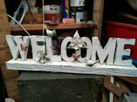 Mettle welcome sign