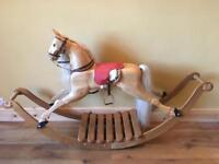 Wooden hand carved rocking horse