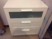 Chest of drawers + bedside table.