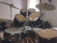 7 piece drum kit plus 2 cymbals and hi-hat and drum sticks