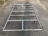 Heavy duty van roof rack with ladder roller