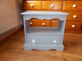 Small grey chalk painted cabinet.