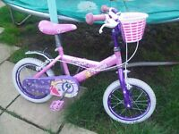 GIRLS PINK AND PURPLE COSMIC PRINCESS BIKE WITH STABILISERS AND BASKET AT FRONT