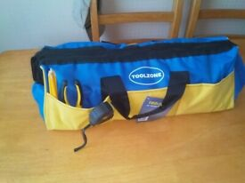 large new tool bag full of all new tools