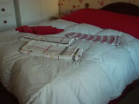 King size bed with mattress, pine headboard, bedding & curtains