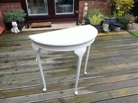 Ornate half round table with balled feet painted grey and white. Excellent condition
