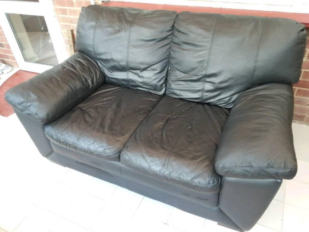 Black leather two seat sofa