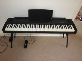 Roland ep-9e digital piano. Complete with lined case.