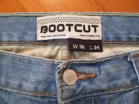 BRAND NEW TOPMAN STONEWASH BOOTCUT JEANS 36W 34L. NEVER WORN, BOUGHT AS A GIFT AND TOO LONG IN LEG.