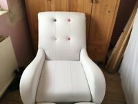 Modern white armchair and matching heart shape stool