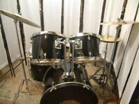 Retired drum teacher has several student drum kits with upgraded cymbals for sale from £199.