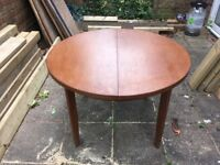 Extendable round to oval (when extended) dark stained dining table
