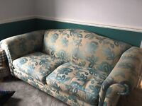 ***Reduced price £30 ***Sofa blue and cream pattern for sale