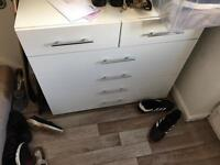 Chest of drawers with black glass tops