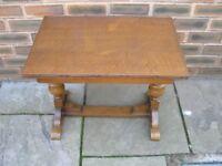 An attractive rectangular oak coffee table.b