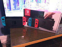 Nintendo Switch Console Red/Blue, 2 Games and 64 Gb Memory Card