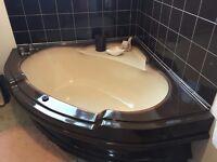 1980's chocolate brown corner bath with wash basin.